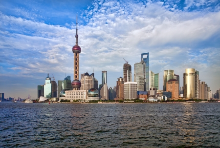 pudong: View on modern Shanghai skyline at sunset, China