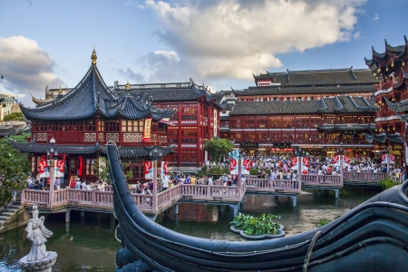 garden center: SHANGHAI - JULY 19: Yu garden on July 19, 2010 in Shanghai, China. View on Huxingting tea house on the back of  traditional chinese buildings and zigzag bridge crowded with people in Yu garden in Old Town of Shanghai Editorial