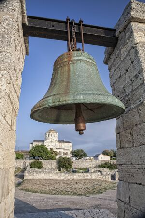Bronze bell on the background of Vladimirsky cathedral in Chersonesos in Crimea, Ukraine Standard-Bild