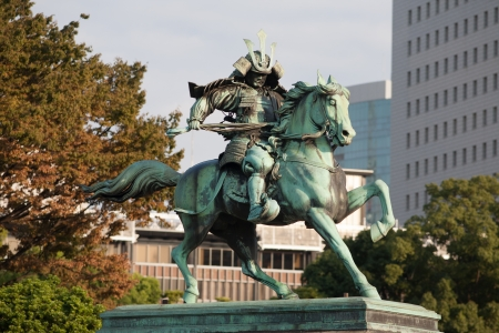 valor: Statue of the great samurai Kusunoki Masashige at the East Garden outside Imperial Palace in Tokyo, Japan Editorial