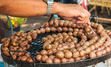 A man Grill sausage made from pork and rice , Thai traditional style Stock Photo - 17921137