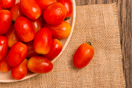 gunny: tomato on gunny and wooden background Stock Photo
