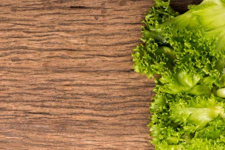 salad greens on woodden background