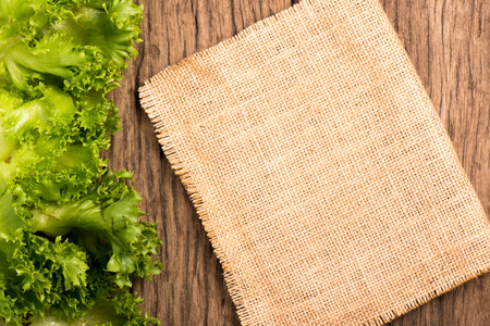 salad greens: salad greens and gunny on wooden background