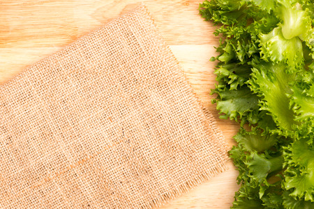 salad greens: salad greens and gunny on chopping block