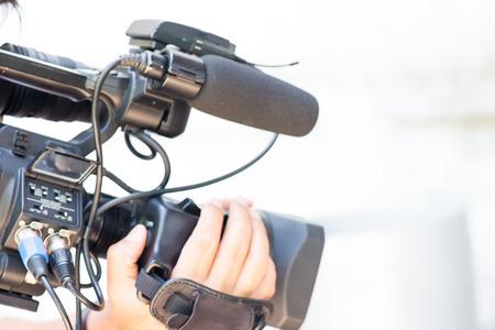 tv camera: Cameraman working on white background