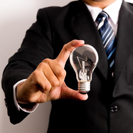 bussinessman: bussinessman show bulb , Idea concept Stock Photo