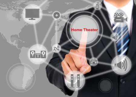 home theater: Businessman pushing on a touch screen interface on home theater button