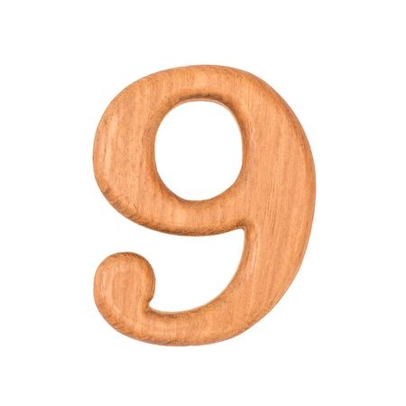 solid figure: numeri in legno 9 isolare su sfondo bianco