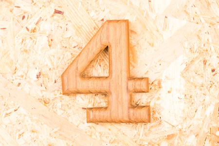 4 of a kind: wooden numbers 4 on recycle wood background Stock Photo