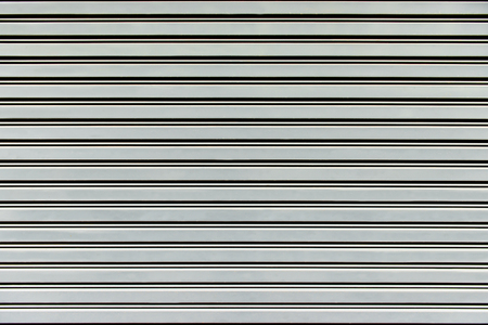 rolling garage door: old steel rolling shutter background Stock Photo