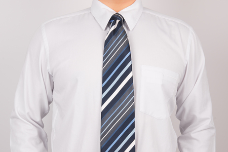 man wearing white shirt and striped tie
