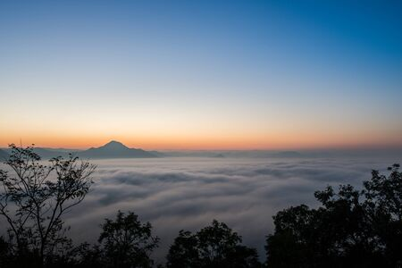 range of motion: sunlight and fog at phu thok chiang khan in loei province thailand