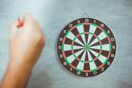 dart on target: A man throw a Plastic tip Dart ,Target aim symbol of goal , business concept