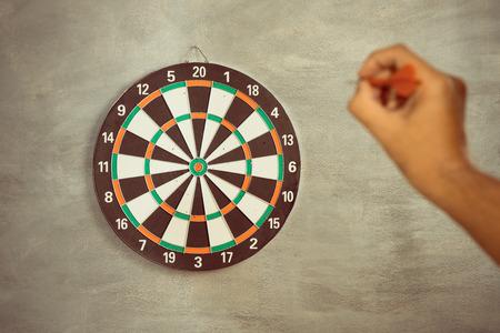 intend: A man throw a Plastic tip Dart ,Target aim symbol of goal , business concept