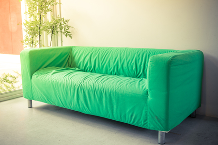 living room sofa: green sofa in living room Stock Photo