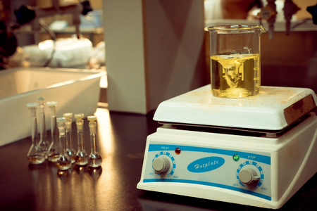 solution mixing liquids on a hotplate in science laboratory