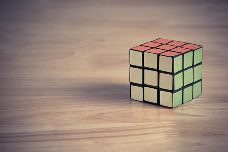 rubik: BANGKOK, THAILAND - MAY 24, 2016: Rubiks cube on the wood background. Rubiks cube on the wood background. Rubiks Cube invented by a Hungarian architect Erno Rubik in 1974.