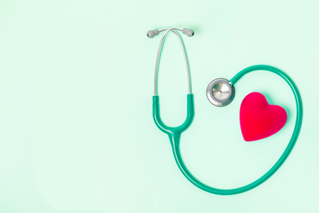 attendance: Stethoscope and red heart on green background