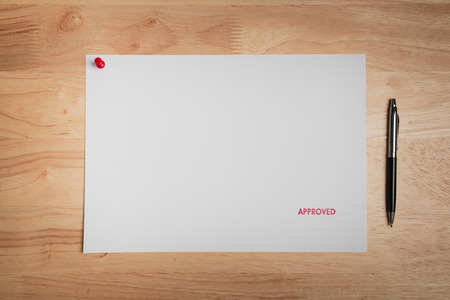 approved stamp: Approved Stamp On white paper with pen Stock Photo