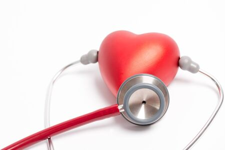 medical attendance: Stethoscope and red heart isolated on white background