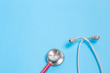 red stethoscope: red stethoscope on blue background