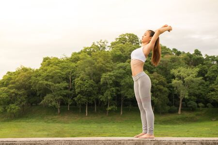 sportswoman: Young sportswoman stretching and preparing to yoga