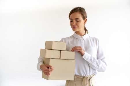 freelance woman working with box at home, small business owner online marketing packaging box and delivery, SME concept 版權商用圖片
