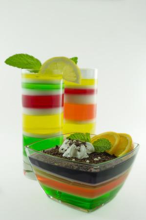 reg: Layered white, green , yellow and reg jello in glass dish. Stock Photo