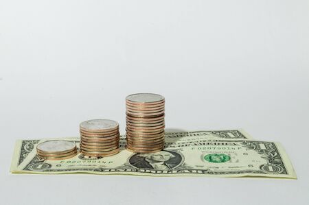 poverty relief: US dollar bills and quarters