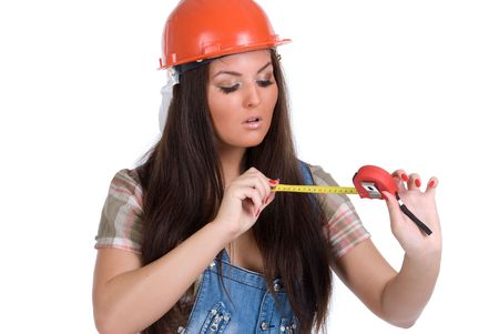 Young woman in orange helmet holding tape measure photo