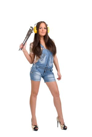 Young woman holding big wrench Stock Photo - 5526210