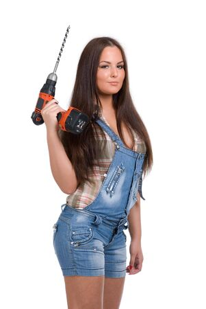 Young woman holding battery drill photo