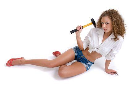 hummer: Beautiful girl holding yellow hummer and nail