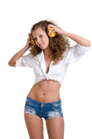 girl in shorts: Beautifil curly girl in yellow headphones Stock Photo