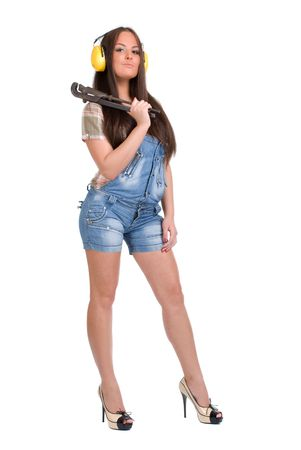 Young woman holding big wrench Stock Photo - 5620188
