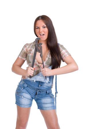 alligator wrench:  Young woman holding big wrench