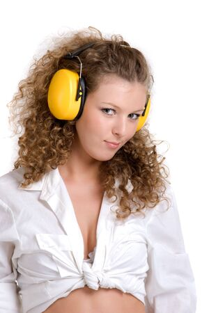 hearing protection: Beautifil curly girl in yellow headphones Stock Photo