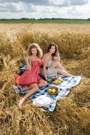 slavonic: Two beautiful slavonic girls on picnic in wheat field