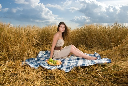 slavonic: Beautiful slavonic girl on picnic in wheat field with fruts
