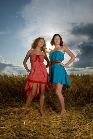 Two beautiful slavonic girls in wheat field photo