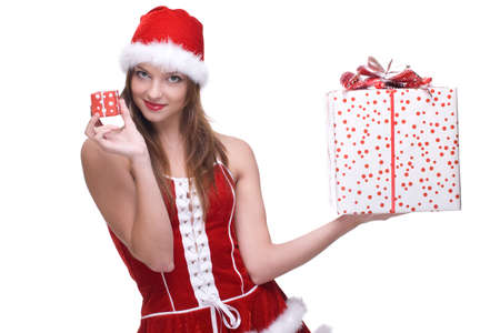 Closeup portrait of beautiful girl with green eyes weared in santa clause dress and some gifts photo