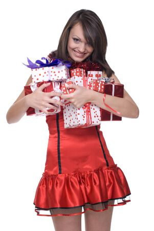 Close up portrait of emotional girl in santa claus dress, white fur and some gifts photo