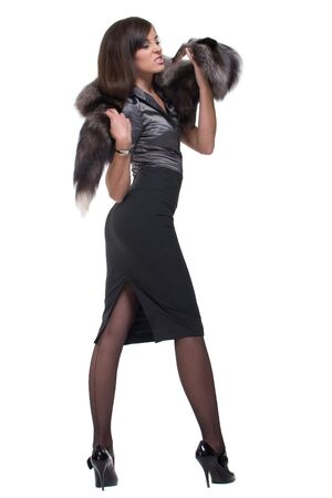 Portrait of young emotional business woman with fur photo