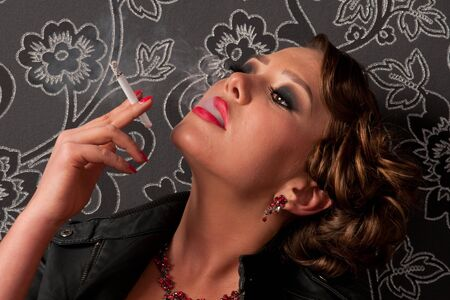 Close up portrait of beautiful elegance glamour woman with cigarette photo
