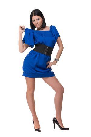 Portrait of beautiful fashion woman in blue dress with black belt photo