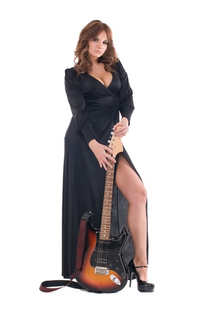 Portrait of beautiful glamour woman in black dress with electric guitar photo