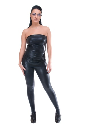 Beautiful girl in black leather suit and fashion make photo