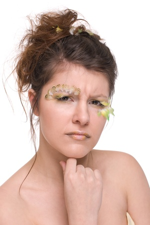 Close up portrait of young and beautiful woman with  feather make up and art photo