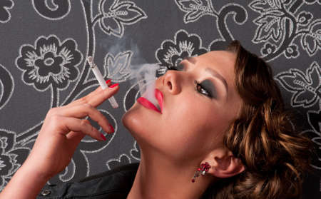 Close up portrait of beautiful elegance glamour woman with cigarette Stock Photo - 8516618